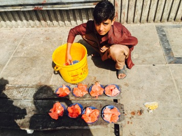 A child and his source of income - selling bird food