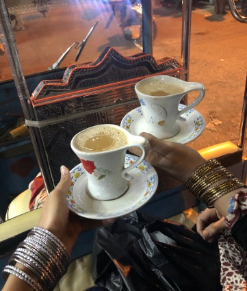 A cup of chai in a rickshaw with our new bangles.